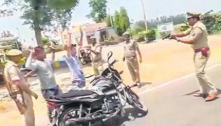Cops check vehicles at gun point in UP' Badaun - Sakshi