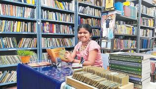 Smallest Librarian Yashoda Special Story - Sakshi