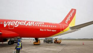 Bikini Airline VietJet kicks off this December with tickets from Rs 9 - Sakshi