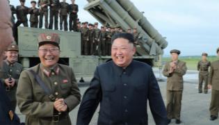 North Koria Press Release Missile Testing Kim Photos - Sakshi