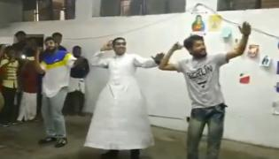 Delhi Priest Dances For Malayalam Song Kudukku Pottiya Kuppayam - Sakshi