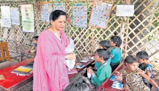 Sharad And Savita Tewari Have Dedicated Their Time To Teach Slum Kids - Sakshi