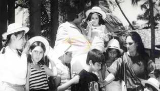 Guess Who Is That Little Kid In Amitabh Bachchan Arms In A Throwback Pic - Sakshi