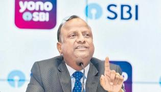 SBI Chairman hopes IBC timeline be adhered to in DHFL - Sakshi