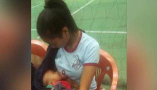 Mizoram Volleyball Player Breastfeeds 7 Months Child In Break Wins Internet - Sakshi