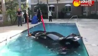 Watch, Pics of car submerged in hotel pool in Florida go viral - Sakshi