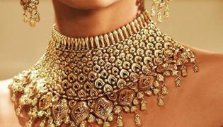 Gold Prices Decline From Record High Range - Sakshi