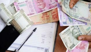 Small savings schemes like PPF NSC and SSCS see big cuts in rates - Sakshi