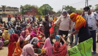 BJPs Raj Sinha Distributes Food Packets Ignores Social Distancing Norms - Sakshi