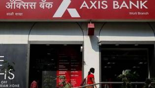 Carlyle group may invest in Axis Bank - Sakshi