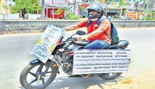 Dr Parikipandla Ashok Is Riding The Bike And Give Coronavirus Awareness To People - Sakshi