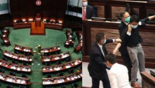 Hong Kong Passes China National Anthem Bill Amid Protests - Sakshi