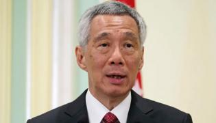 Singapore PM Lee Hsien Loong returns to power with clear mandate - Sakshi