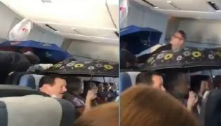 Passengers On Russian Flight Hold Up Umbrellas Video Goes Viral  - Sakshi