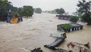 Bihar: 21 Dead Due To Floods Over 69 Lakh People Affected - Sakshi