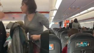 Maskless Woman Yells Everybody Die And Coughs On Passengers - Sakshi