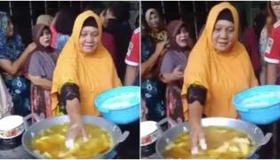 Viral Video Woman Dipping Her Hand in Hot Oil to Fry Food - Sakshi