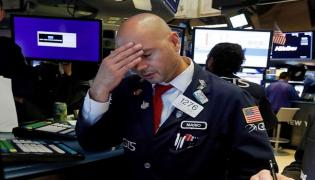 Wall street tumbles on Covid-19 fears - Sakshi