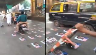 Viral French President Emmanuel Macron Posters On Mumbai Road - Sakshi