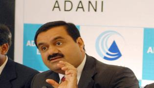 Total to acquire 20pc stake in Adani Green Energy - Sakshi