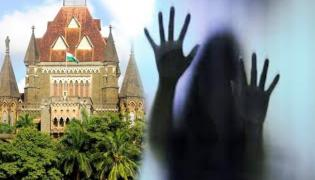 Skin to skin contact not sexual assault under Pocso Act Says Bombay HC - Sakshi