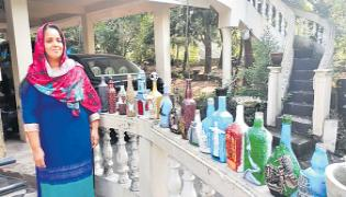 Jisna Nagirsha enters records book with bottle art of seven wonders - Sakshi