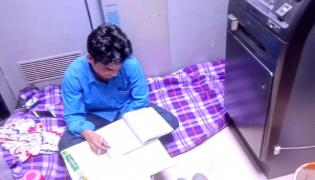 Security Guard Studies On Ground ATM Machine Viral - Sakshi