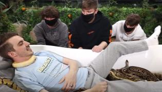 Sit On Snake Video Bizarre Challenges Left Netizens Shocked - Sakshi