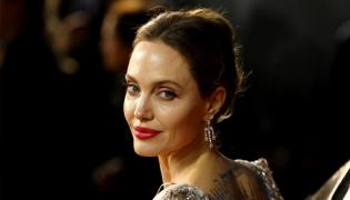 Amid Clashes with Brad Pitt, Angelina Jolie Reunited With Ex-husband - Sakshi