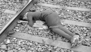 The Young Woman Attempted Suicide on Railway  track - Sakshi