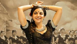 Dhigu Dhigu Dhigu Naga Lyrical Song Out From Varudu Kavalenu Movie - Sakshi