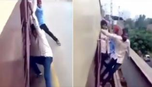 Boy Attempts Dangerous Stunts on Moving Train, Video Will Shock You - Sakshi