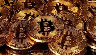 Bloomberg Analyst Says Bitcoin May Touch 100000 Dollar by End of 2021 - Sakshi