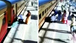 Viral Video Of Woman Slips While Trying To Board Moving train In Mumbai - Sakshi