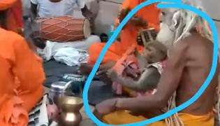 Monkey chanting started playing devotion of God video going viral - Sakshi