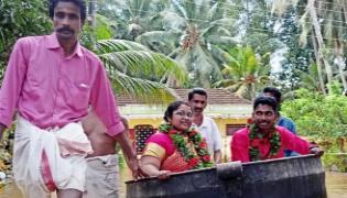 Viral: Kerala Couple Float Cooking Vessel Reach Flooded Wedding Hall - Sakshi