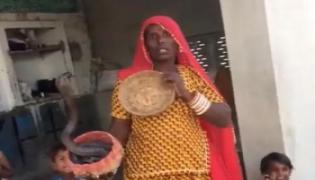 Woman Threatens Medical Team Snake Unwilling Take Covid 19 Vaccine Rajasthan Ajmer - Sakshi