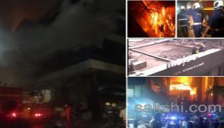 massive fire mumbai kamala mills building - Sakshi