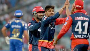 Mumbai knocked out Delhi Daredevils win by 11 runs - Sakshi