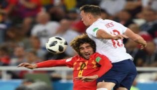 Belgium beat England 1-0 to top Group G Photo Gallery - Sakshi