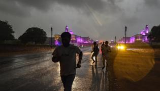 Heavy rains in new delhi Photo Gallery - Sakshi