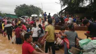 hundreds reported missing laos after dam collapse Photo Gallery - Sakshi