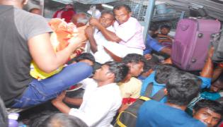 Railway stations and bus stations teeming with crowd Phot Gallery - Sakshi