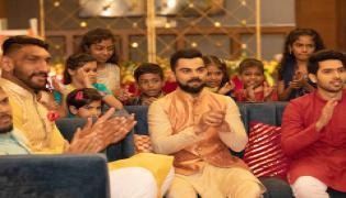 Virat Kohli Lights up Lives of 'Dharavi Reloaded' Kids Photo Gallery - Sakshi