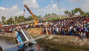Bus Falls Into Canal in Karnataka Photo Gallery - Sakshi