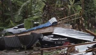 tsunami hits beaches in Indonesia Photo Gallery - Sakshi