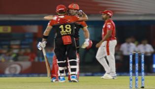 Royal Challengers Bangalore beat Kings XI Punjab for first win of the season - Sakshi