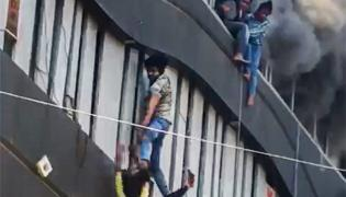 Fire Accident Taxshila Complex in Surat Photo Gallery - Sakshi