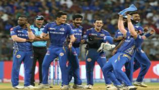 Mumbai cruise to playoffs after super over win against Hyderabad Photo Gallery - Sakshi