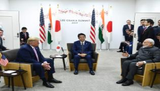 PM Modi holds trilateral meeting with Trump Photo Gallery - Sakshi